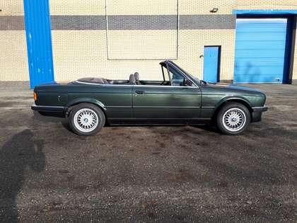 BMW 325 i cabrio E30 (1986) dark green manual 6 cyl. 32 yr